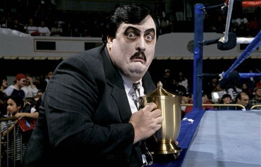 This undated photo released Wednesday, March 6, 2013, by WWE, Inc. shows William Moody, aka Paul Bearer, the pasty-faced, urn-carrying manager for performers The Undertaker and Kane. A spokesman for the wrestling circuit said Moody's family contacted the WWE to report his death on Tuesday, March 5, 2013. He was 58. No cause was released. (AP Photo/WWE Inc.)
