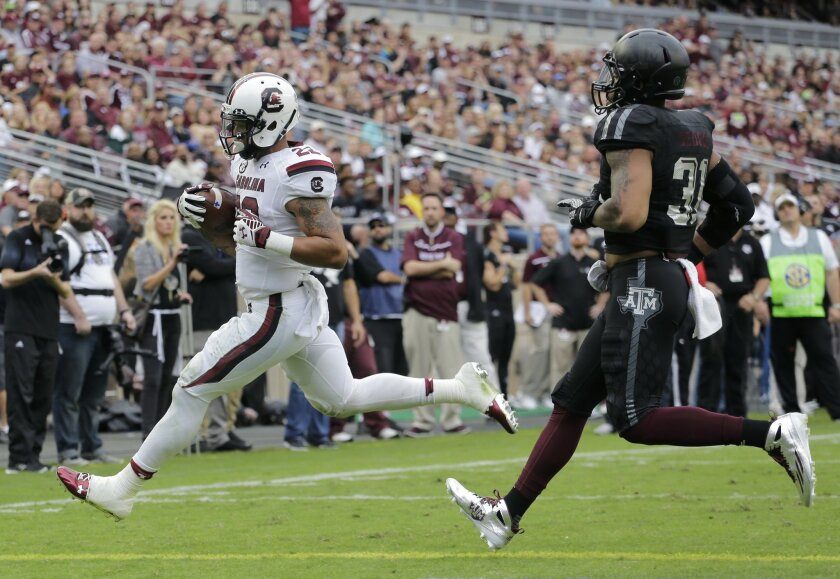 South Carolina running back Brandon Wilds (22) outruns Texas A&M linebacker Claude George (31) as he scores a touchdown during the first half of an NCAA college football game, Saturday, Oct. 31, 2015, in College Station, Texas. (AP Photo/Eric Gay)