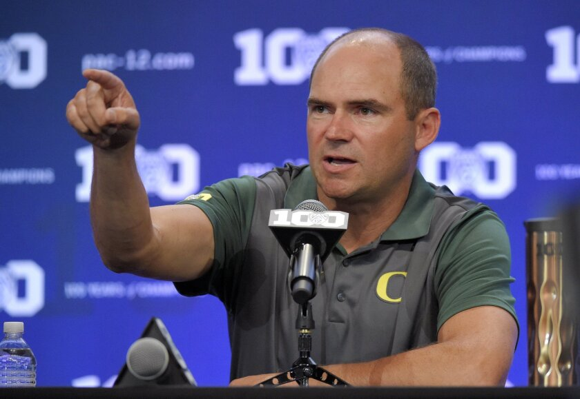 Oregon head coach Mark Helfrich speaks to reporters during NCAA college Pac-12 Football Media Days, Friday, July 31, 2015, in Burbank, Calif. (AP Photo/Mark J. Terrill)