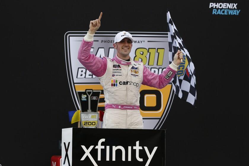 Austin Cindric celebrates in Victory Lane after winning a NASCAR Xfinity Series auto race at Phoenix Raceway, Saturday, March 13, 2021, in Avondale, Ariz. (AP Photo/Ralph Freso)
