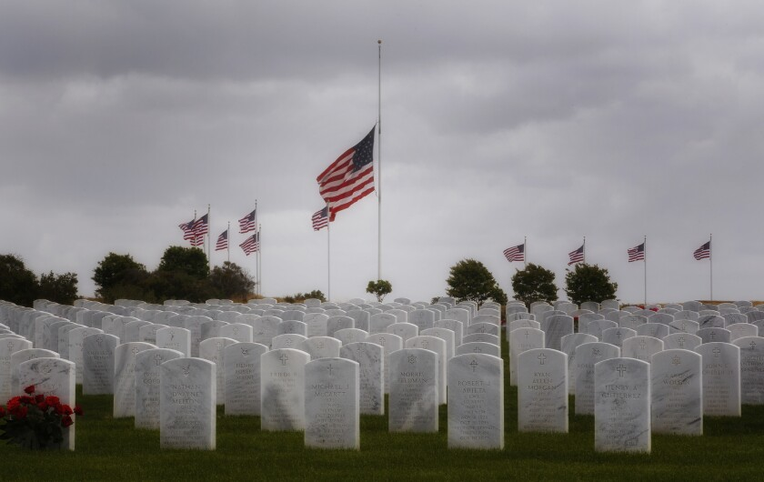 Flags flown at half staff to honor the days burials at Miramar National Cemetery.