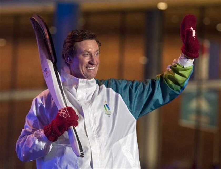 Wayne Gretzky waves to the crowd after lighting the Olympic cauldron during the opening ceremonies at the 2010 Vancouver Olympic Winter Games in Vancouver, British Columbia, Friday Feb. 12, 2010. (AP Photo/The Canadian Press, Adrian Wyld)