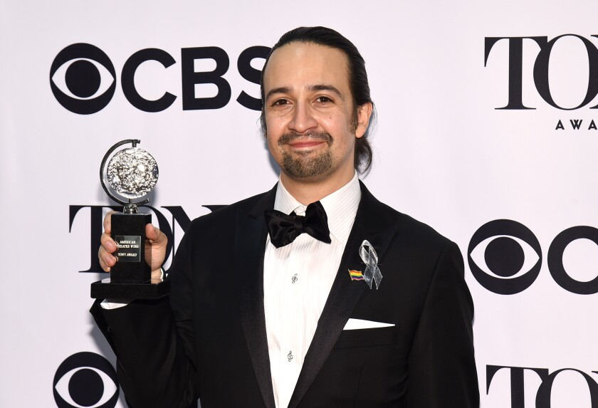 Lin-Manuel Miranda poses with the award for best musical at the Tony Awards on June 12.