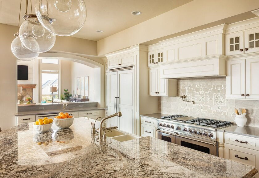 Lighting and surface finishes are both important to consider when remodeling a kitchen, but ultimately, the layout of the overall space should be the number one focus.