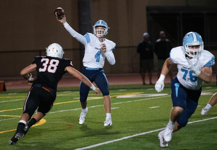 Ethan Garbers throws the ball in Corona del Mar's Sunset League opener at Huntington Beach on Thursday.