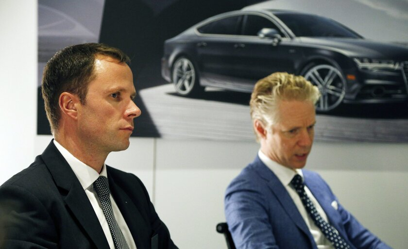 Scott Keogh, president of Audi of America, right, and Siegfried Pint, Audi's head of electric powertrain, speak with the media during a roundtable at the Los Angeles Auto Show on Wednesday, Nov. 18, 2015, in Los Angeles. (AP Photo/John Locher)
