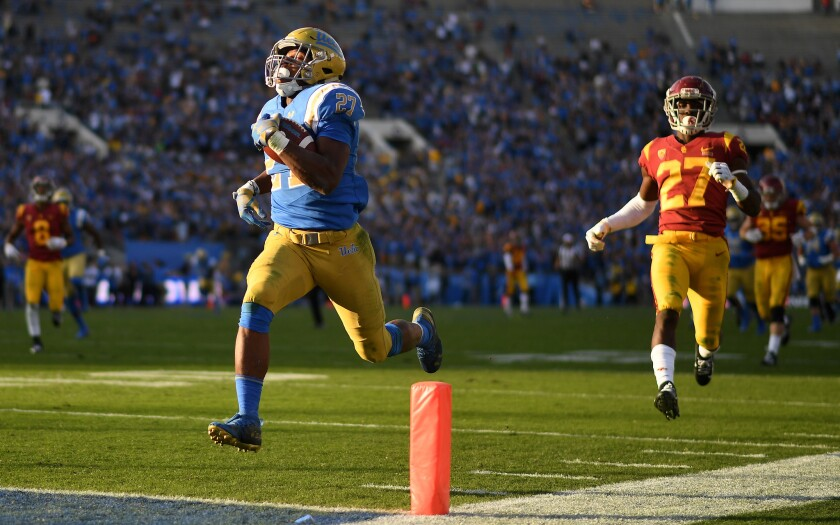 UCLA running back Joshua Kelley scores a 55-yard touchdown against USC.