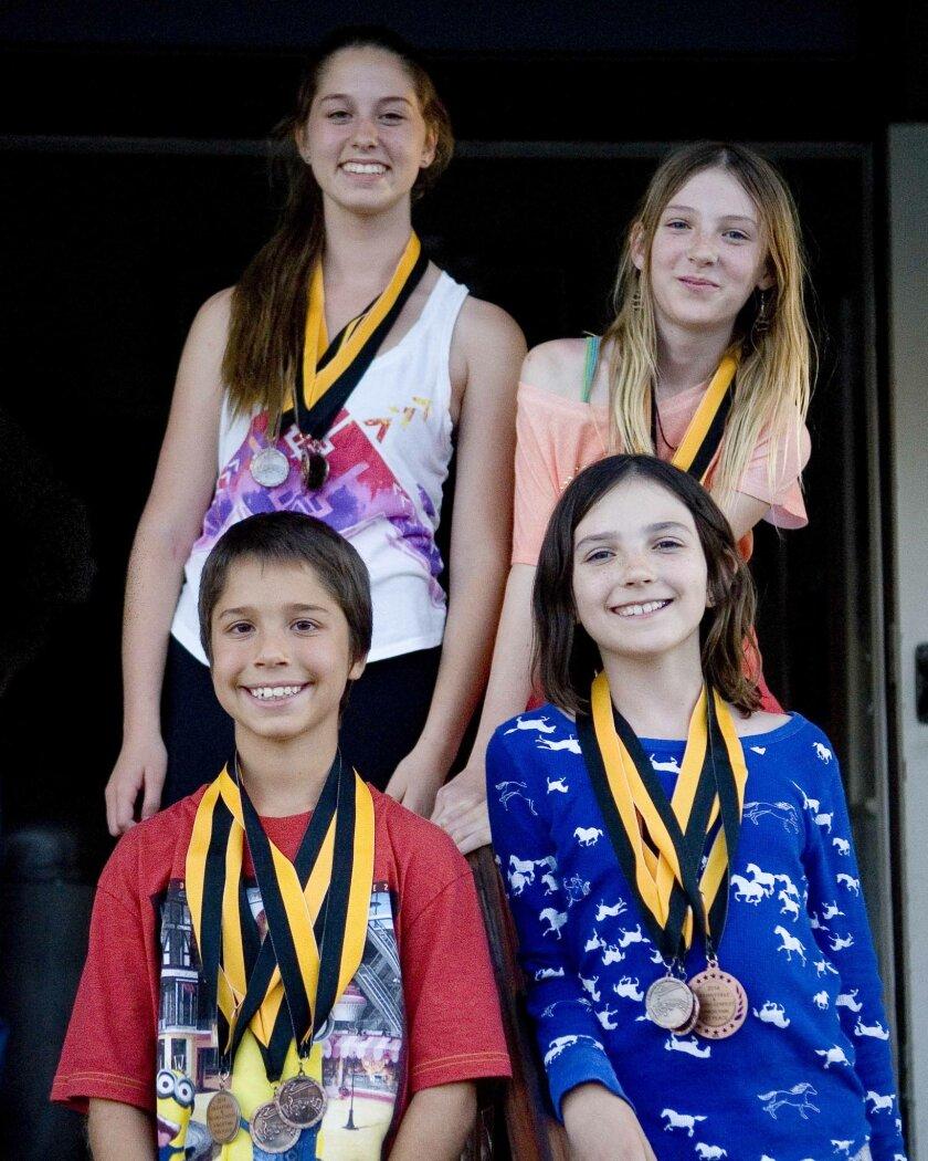 """Julian Fiddle and Pickin' Contest"" winners: front row, Ezra Ellisman (left) and Violet Humphrey. Back row, Shira Ellisman (left) and Willow Humphrey."