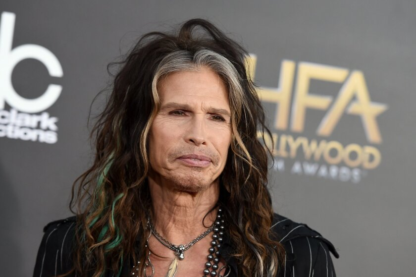 """FILE - In this Friday, Nov. 14, 2014, file photo, Steven Tyler arrives at the Hollywood Film Awards at the Palladium, in Los Angeles. Aerosmith frontman Tyler is asking Republican presidential candidate Donald Trump to stop using the power ballad """"Dream On"""" at campaign events. (Photo by Jordan Stra"""