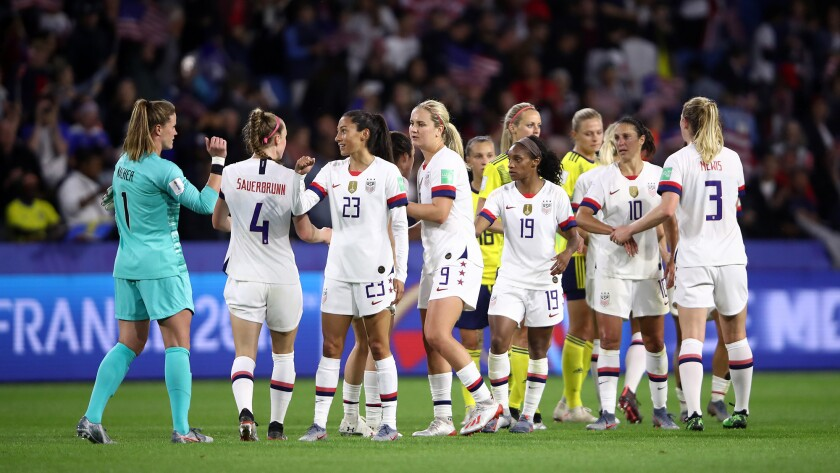 The U.S. women's national soccer team celebrates following a 2-0 victory over Sweden in World Cup group play on Thursday. The United States plays Spain in the round of 16 on Monday.