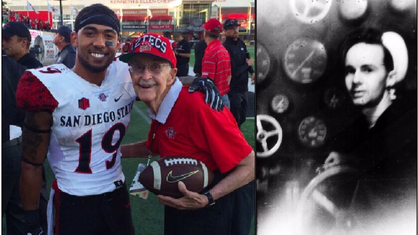 SDSU's D.J. Pumphrey poses with Tom Ables after Northern Illinois win two weeks ago. It was the 773rd Aztecs game attended by Ables, who will join the team this week at South Alabama. Beforehand, Ables plans to visit the USS Alabama, the ship he served on (right) 70 years ago.