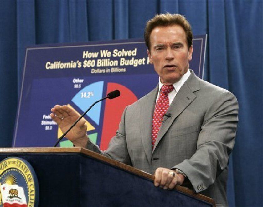 Gov. Arnold Schwarzenegger discusses the legislature's passage of a package of about 30 bills to deal with the state's $26 billion state budget deficit during a Capitol news conference in Sacramento, Calif., Friday, July 24, 2009.  Lawmakers worked through the night to approve the complex package o