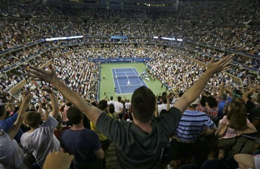 Fans react after the match between Andy Roddick and Australia's Bernard Tomic in the third round of play at the 2012 US Open tennis tournament,  Friday, Aug. 31, 2012, in New York. (AP Photo/Mike Groll)