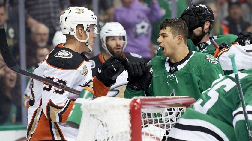 Dallas Stars defenseman Connor Carrick (5) has words with Anaheim Ducks left wing Max Comtois (53) d