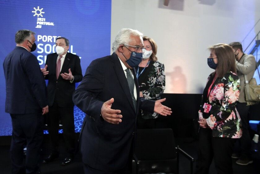 Portugal's Prime Minister Antonio Costa gestures as he attends the opening ceremony of an EU summit at the Alfandega do Porto Congress Center in Porto, Portugal, Friday, May 7, 2021. European Union leaders are meeting for a summit in Portugal on Friday, sending a signal they see the threat from COVID-19 on their continent as waning amid a quickening vaccine rollout. Their talks hope to repair some of the damage the coronavirus has caused in the bloc, in such areas as welfare and employment. (AP Photo/Luis Vieira, Pool)