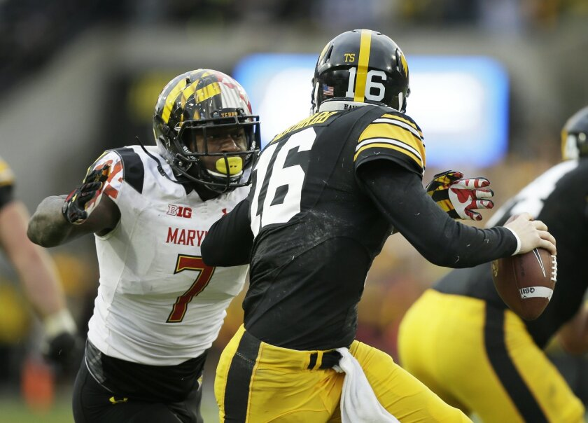 In this Saturday, Oct. 31, 2015, photo, Maryland defensive lineman Yannick Ngakoue, left, chases Iowa quarterback C.J. Beathard during the second half of an NCAA college football game, in Iowa City, Iowa. After doing a decent job stopping the run against Iowa last weekend, Maryland's defense is poi