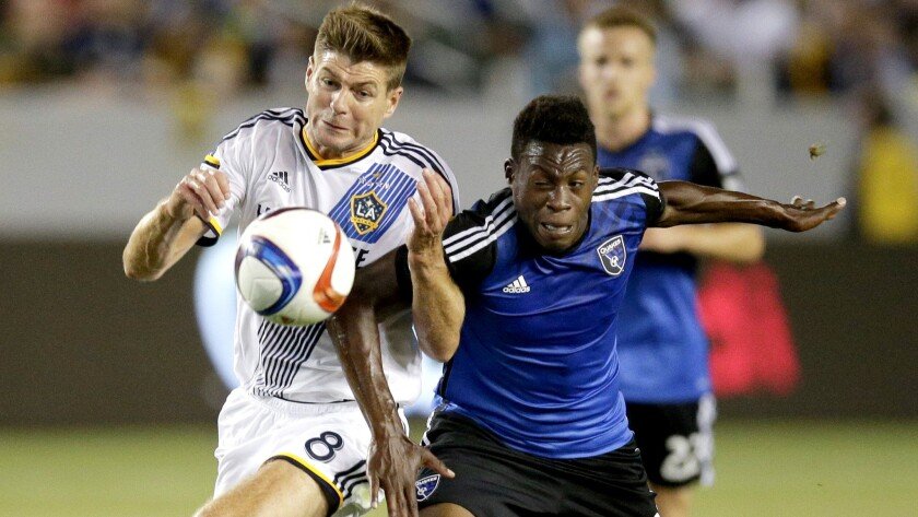 Galaxy midfielder Steven Gerrard, left, Earthquakes midfielder Fatai Alashe vie for possession of the ball during an MLS game on July 17.