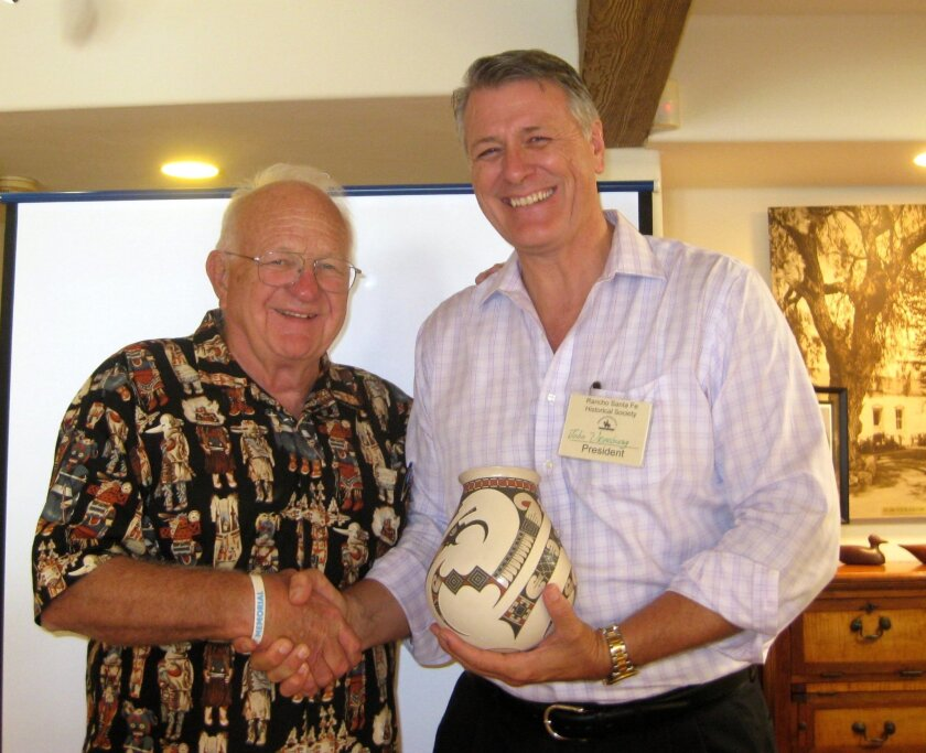 Dr. James Kemp and John Vreeburg, president of RSFHS, accepting a gift for the Historical Society from Dr. Kemp. Courtesy photo