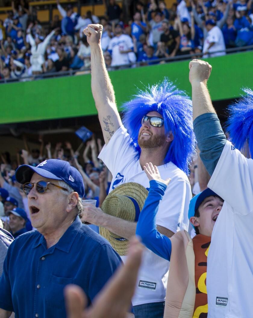 LOS ANGELES, CALIF. -- THURSDAY, MARCH 28, 2019: Dodgers fans celebrate Cody Bellinger's seventh-inn