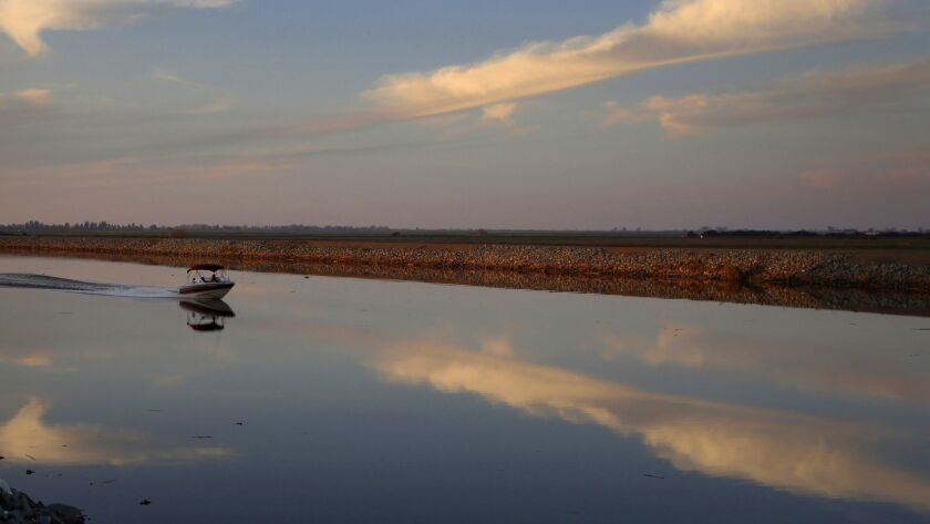 A motorboat drives down Whiskey Slough in the Sacramento-San Joaquin River Delta, just outside of Stockton.