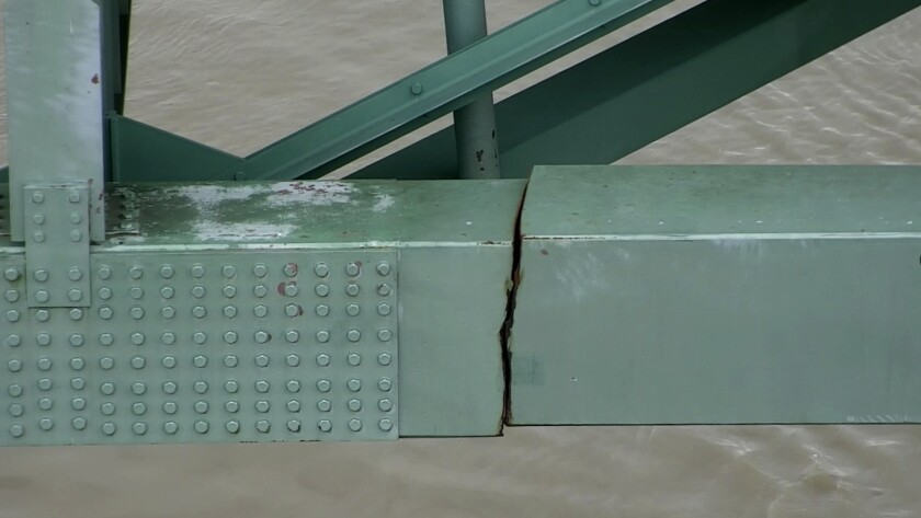 FILE - This undated photo released by the Tennessee Department of Transportation shows a crack in a steel beam on the Interstate 40 bridge, near Memphis, Tenn. The Interstate 40 bridge linking Arkansas and Tennessee that was closed after a crack was found in the span will begin reopening next week. Transportation officials on Wednesday, July 28, 2021, said the eastbound lanes of the Hernando DeSoto Bridge over the Mississippi River will reopen to limited traffic on Monday morning. (Tennessee Department of Transportation via AP, File)