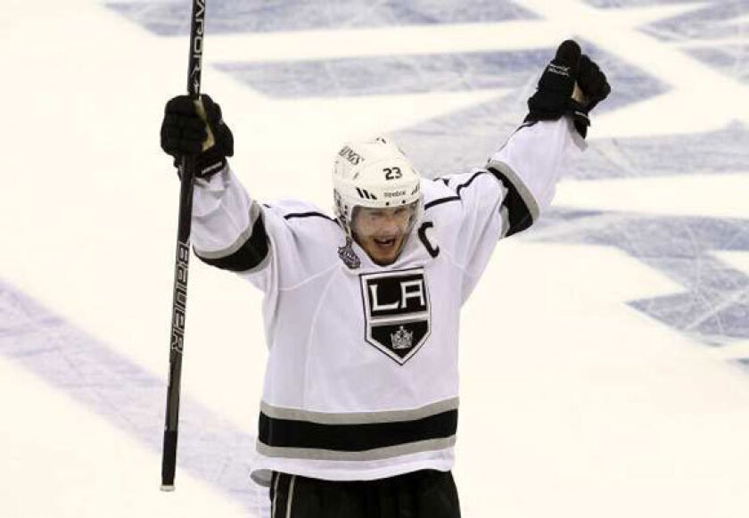 Dustin Brown celebrates after the Kings' Game 2 victory over New Jersey.
