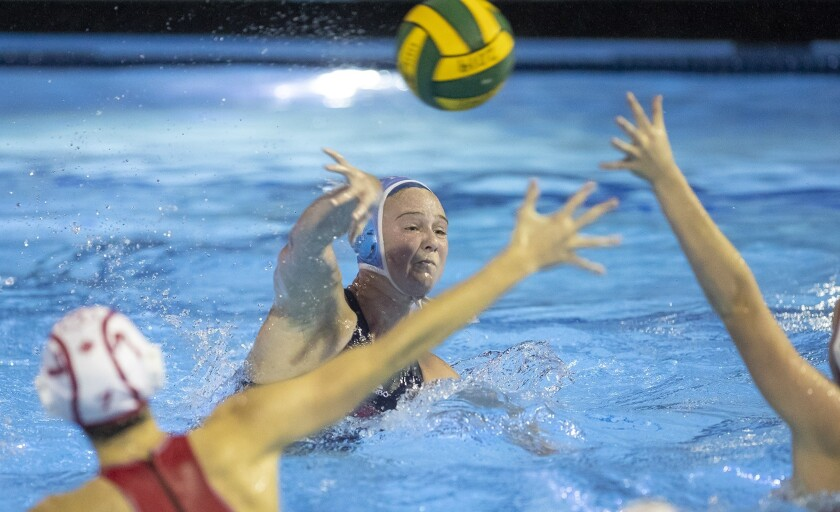 Corona del Mar's Sophie Wallace takes a shot against Orange Lutheran defenders during the CIF Southe