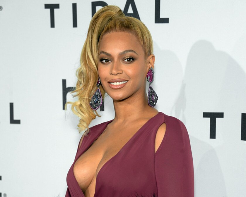 "FILE - In this Oct. 20, 2015 file photo, singer Beyonce arrives at TIDAL X: 1020 Amplified by HTC at the Barclays Center in New York. A day before her performance at Sunday's Super Bowl halftime show, Beyonce has dropped a new song. Beyonce released ""Formation"" on Saturday, Feb. 6, 2016 as a free d"