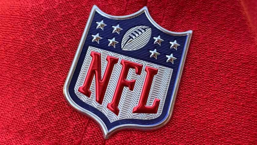 The official NFL logo is seen on the back of a hat.