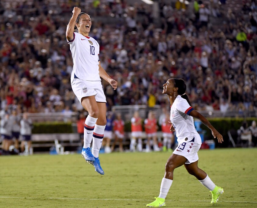 PASADENA, CALIFORNIA - AUGUST 03: Carli Lloyd #10 of the United States celebrates her goal with Crystal Dunn #19, to take a 3-0 lead over the Republic of Ireland, during the first half of the first game of the USWNT Victory Tour at Rose Bowl on August 03, 2019 in Pasadena, California. (Photo by Harry How/Getty Images) ** OUTS - ELSENT, FPG, CM - OUTS * NM, PH, VA if sourced by CT, LA or MoD **