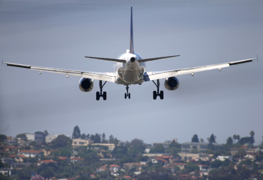 A United Airlines jet approaches San Diego International Airport for a landing.