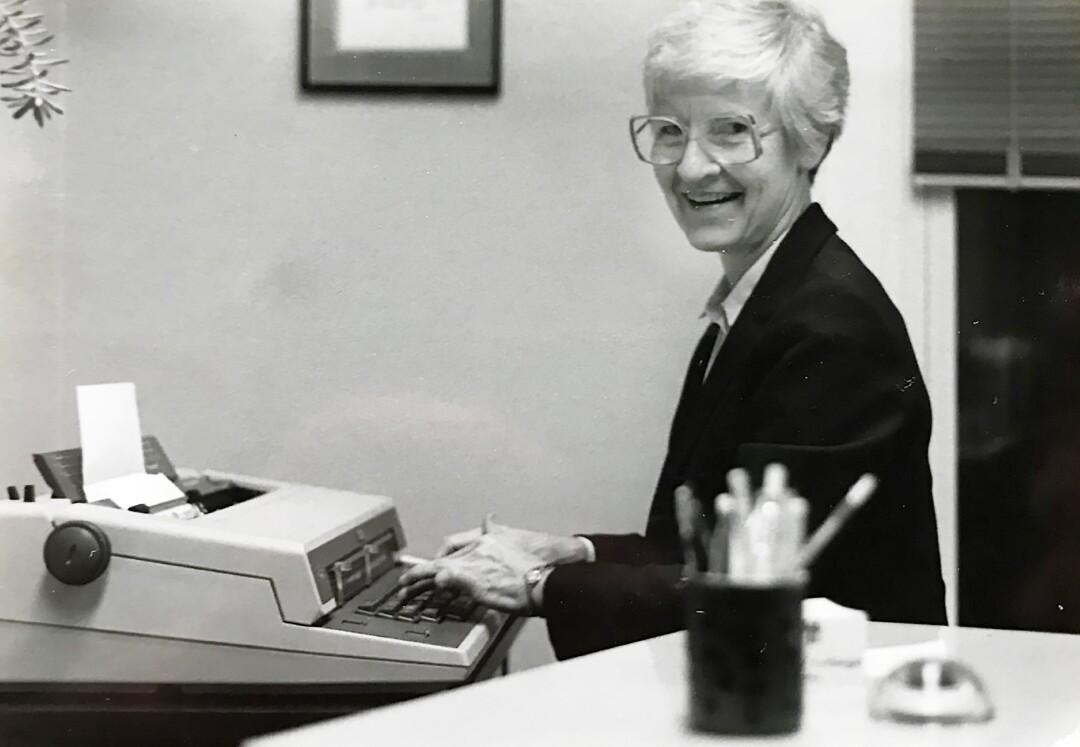 Sister Marie Brinkman writing in her office in Leavenworth, Kan., in 1984.
