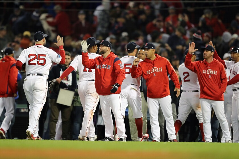 The Boston Red Sox celebrate their win over the Houston Astros in Game Two of the American League Championship Series at Fenway Park on October 14, 2018 in Boston, Massachusetts. The Red Sox defeated the Astros 7-5.