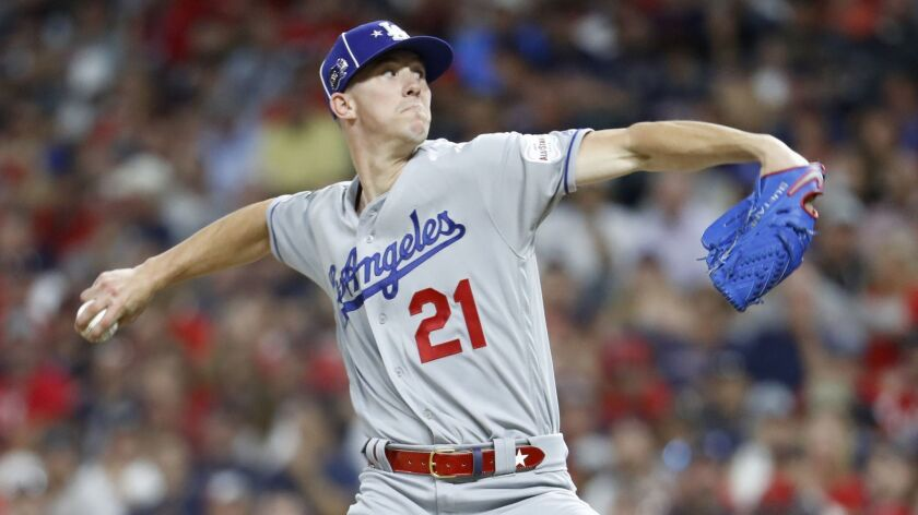National League pitcher Walker Buehler, of the Los Angeles Dodgers, throws during the fifth inning o