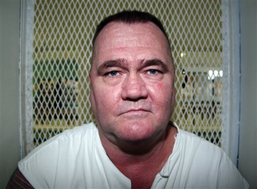 In this Aug. 29, 2012, photo, convicted killer Cleve Foster speaks from a visiting cage at the Texas Department of Criminal Justice Polunsky Unit outside Livingston, Texas.  Foster has received three reprieves from the U.S. Supreme Court, including two last year when he was within hours of executio