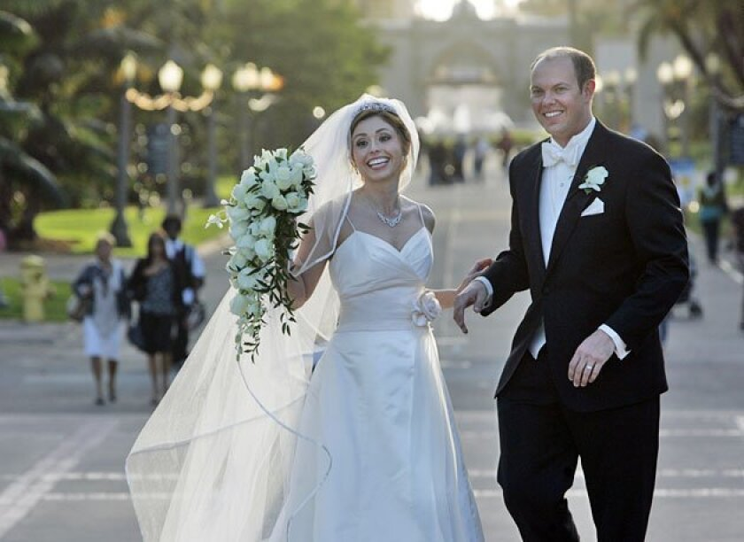 Heather Hendren and Mike Kiesling saved by choosing the Museum of San Diego History for their reception. (Peggy Peattie / Union-Tribune)