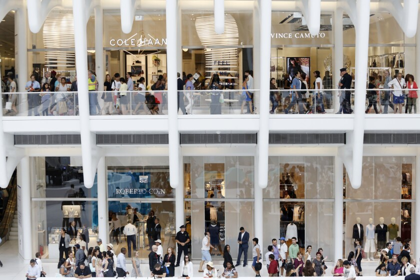 Shoppers walk on two levels of the newly opened Westfield World Trade Center mall in New York City.