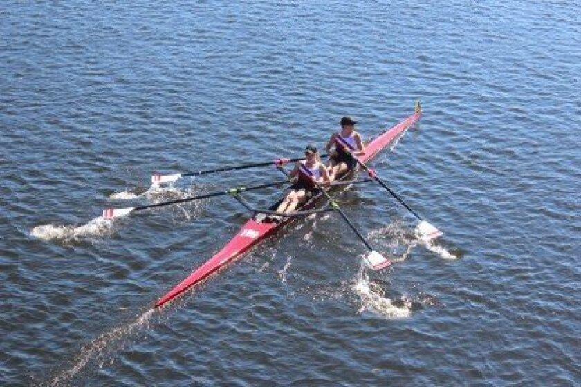 a Jolla High School senior Marissa Gibson and Torrey Pines High senior Alexandra Tatro compete at the Head of the Charles Regatta event in Boston. Courtesy Photos
