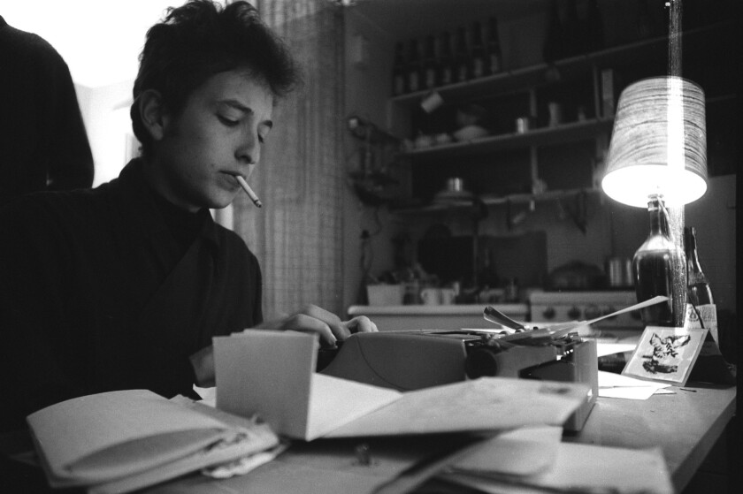 Bob Dylan at work in his Greenwich Village apartment, 1964.