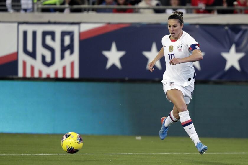 USWNT forward Carli Lloyd moves toward the ball during a match