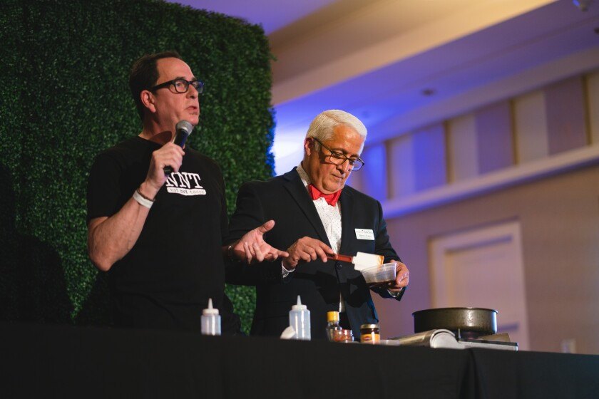 "Host Sam ""The Cooking Guy"" Zien and Mama's Kitchen CEO Alberto Cortés at the 2018 Mama's Day event."