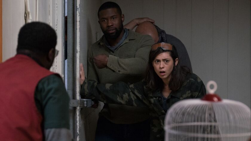 """Rosa Salazar, pictured right with Lil Rel Howery and Trevante Rhodes, on her """"Bird Box"""" character's fate: Did Lucy and Felix go back to the supermarket?"""