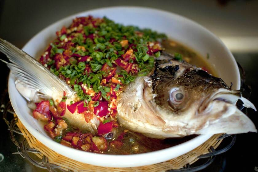 Steamed fish head in a chile-laden broth is favorite at Hunan Mao in Rosemead.
