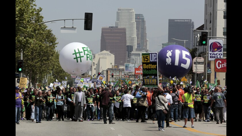 Fight for 15 protesters march down Figueroa Street in Los Angeles during a 2015 rally.