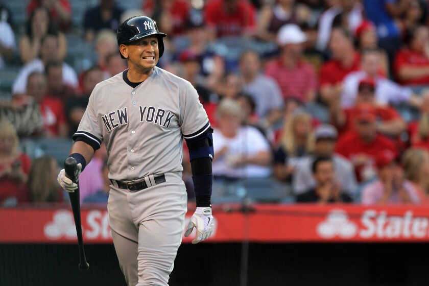 Alex Rodriguez reacts after striking out against Andrew Heaney during the Angels' 2-1 victory over the New York Yankees on Tuesday at Angel Stadium.