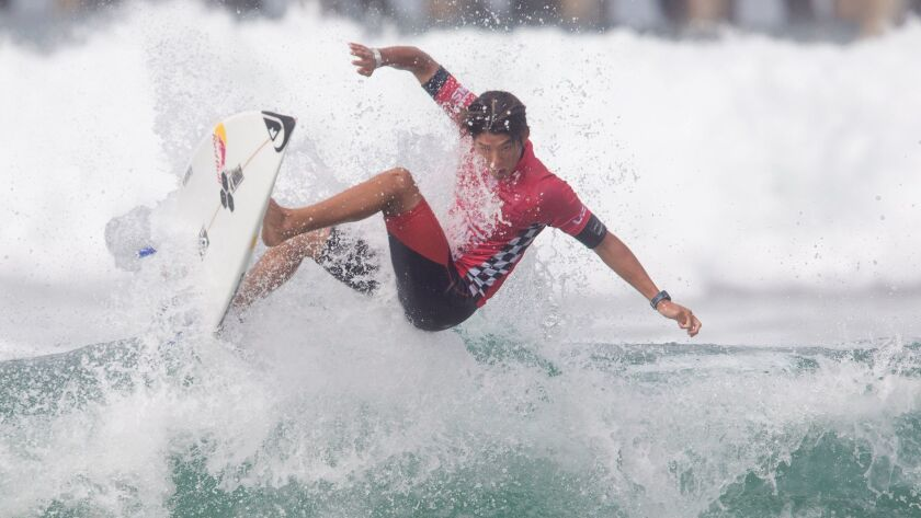 Kanoa Igarashi, shown catching a wave at the U.S. Open of Surfing in 2017, is a two-time event champion.