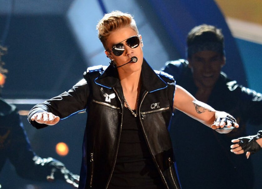Singer Justin Bieber performs during the 2013 Billboard Music Awards May 19 in Las Vegas.