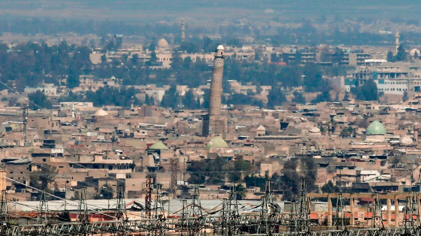 A picture taken on March 24, 2017 shows a general view of the west Mosul skyline featuring the leani