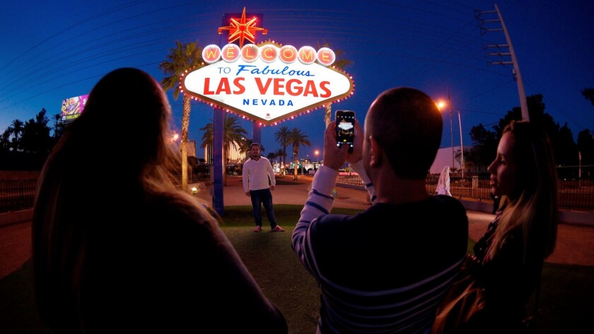 "Tourists takes photos with the ""Welcome to Fabulous Las Vegas"" sign on the Strip Saturday, February"