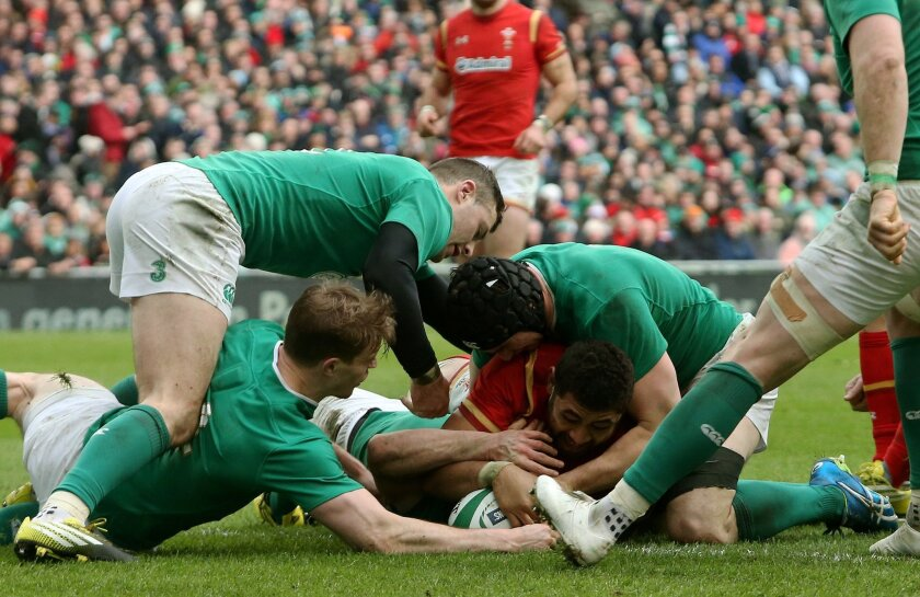 Wales' Taulupe Faletau, bottom centre, scores a try under pressure from Ireland players during their 2016 Six Nations rugby match at the Aviva Stadium in Dublin, Sunday Feb. 7, 2016. (Brian Lawless / PA via AP) UNITED KINGDOM OUT - NO SALES - NO ARCHIVES